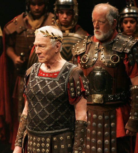 Christopher Plummer (left) as Caesar and Peter Donaldson (right) as Rufio, with members of the company