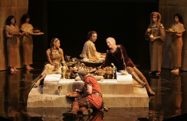 Nikki M. James (seated, clockwise from left) as Cleopatra, Gordon S. Miller as Apollodorus, Christopher Plummer as Caesar and Peter Donaldson as Rufio, with members of the company.