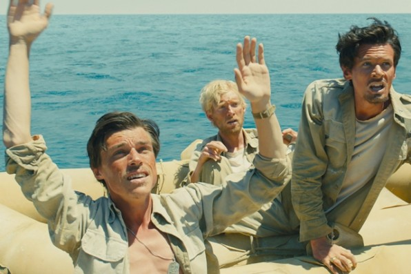 UNBROKEN - 2014 FILM STILL - (L to R) Mac (FINN WITROCK), Phil (DOMHNALL GLEESON) and Louie (JACK O'CONNELL) - Photo Credit: Universal Pictures    © 2014 Universal Studios. ALL RIGHTS RESERVED.
